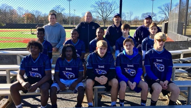 """Representing the Tennessee Titans in the NFL Flag Championship are athletes Keion L. Stafford, Chase D. Honeycutt, Joshua D. Ferguson, Brent A. Rowe, Taysean V. Jefferson, Charles R. Oden, Skylar M. Bowlin, John W. Busey, Alexander """"A.J."""" Bonner and Kylan I. Jones with head coach Cameron Goss, assistant coach Jackie Holt and defense coaches Steve Penn and David Bonner."""