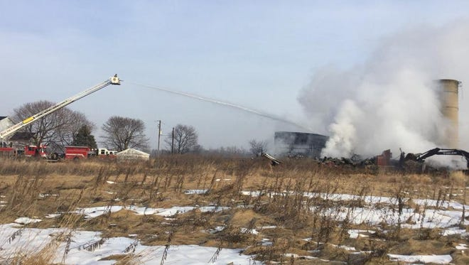 Fire crews worked to get a barn fire under control for nearly six hours Sunday morning.