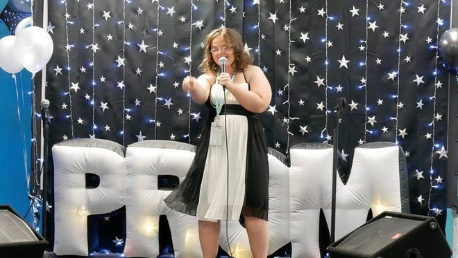 Reagan Brown belting out some tunes during the Karaoke portion of last year's Night to Shine Prom.