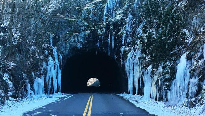 Ice frames a tunnel near Little Switzerland on the Blue Ridge Parkway earlier this winter. The parkway is mostly closed in Western North Carolina due to icy road conditions.