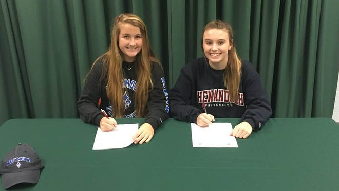 Liza Ervin (left) and Kaitlyn Morris (right) declare their intent to play lacrosse at the college level.