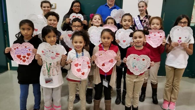 Members of the Boys & Girls Club of Vineland along with Chris Volker, executive director, Boys & Girls Club of Vineland, Miss Vineland Sarah Layton and Miss New Jersey Oustanding Preteen Kylee Howerton participated in a Valentines for Veterans project at the club.