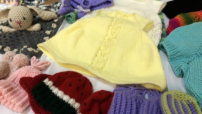 Knit Wit members spent many hours hand-crafting clothes for CASTLE babies.