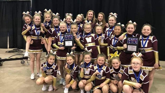 One of the Windsor Youth Cheer squads celebrate their 2nd place finish at a recent state championship.