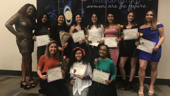 """The HerVoice committee posed after the release party of the magazine they created to showcase their theme of """"Womxn are the Future."""""""