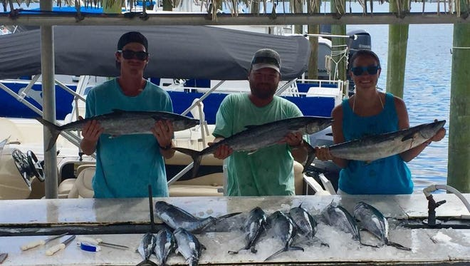 Ryan Johnson, Dylan Johnson, and Leanne Harris with a nice catch of king mackerel they caught trolling a few miles off Pensacola Beach.