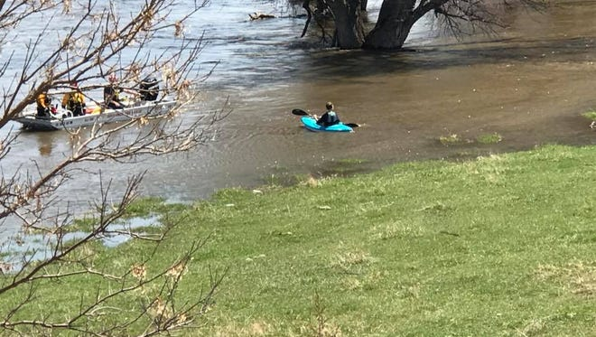 A kayaker was rescued from the Big Sioux River on Sunday. This photo was taken after the rescue and shows the high water levels.