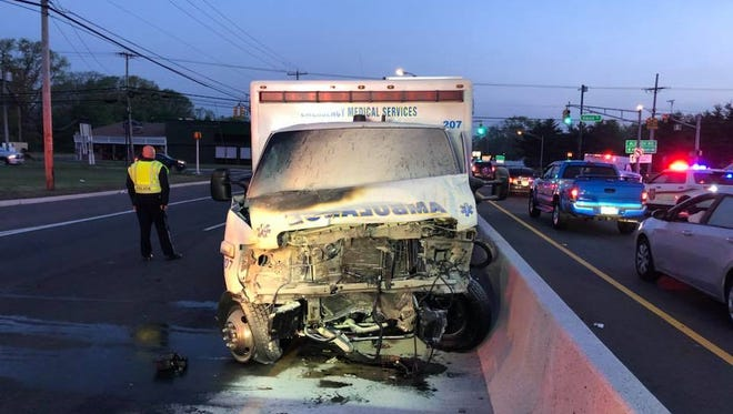This MONOC ambulance caught fire after a crash on Route 9 in Howell Wednesday.