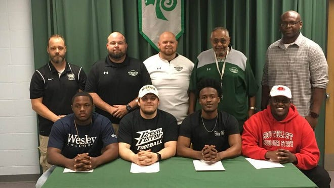 Parkside's Tyler Poulson, Brandon Burkhardt, Nayel Oge and Ernest Ayieko announce their intent to play football at the college level on Tuesday.
