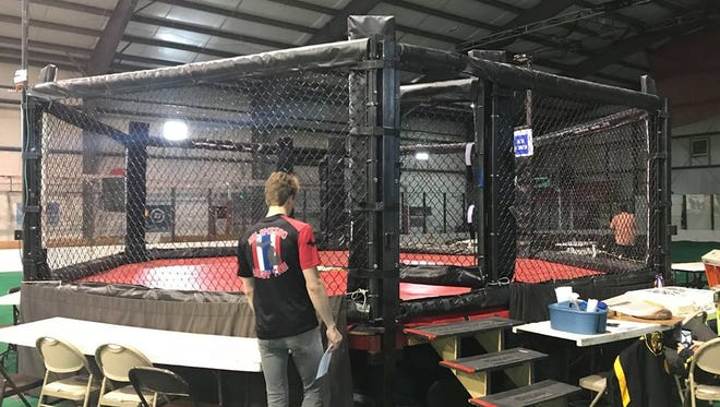 The cage for the fight was set up in the middle of Classic City Center, an athletic training facility and event center in Waterloo, Indiana.