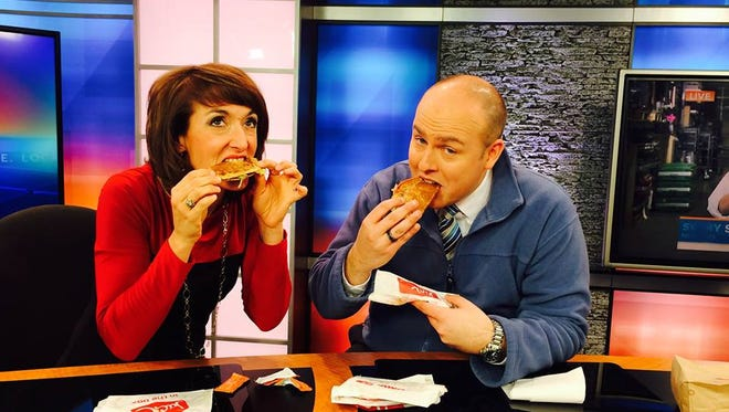 Beth Brotherton and Mike McCormick eating tacos on the set of WYFF