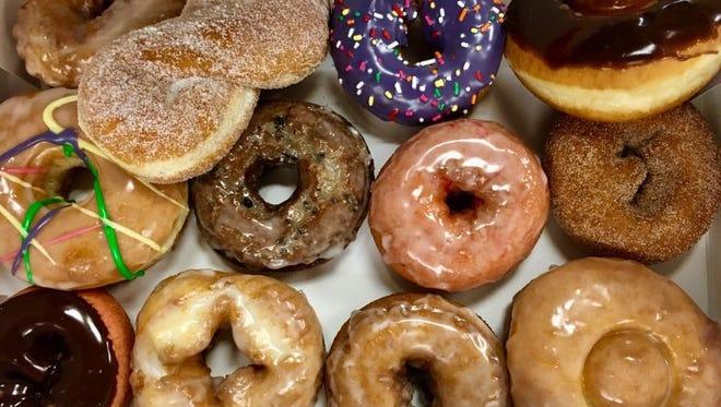 An assortment of a dozen doughnuts from Groovy Donuts.