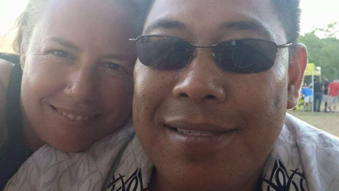 Cloyd Edralin, right, a green card holder who has lived in the U.S. for 30 years, poses for a picture with his wife, Brandi Davison-Edralin. Edralin was detained by immigration officers Monday morning over an 11-year-old firearm conviction.