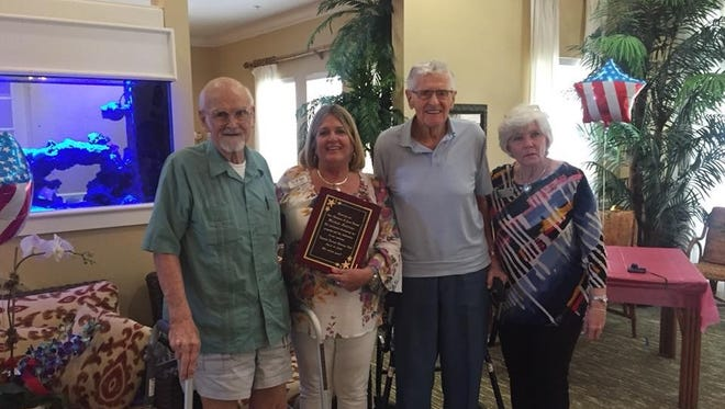 Members of the Veterans Club present Trilogy Home Healthcare's Michele Andrews with its Star Volunteer award.