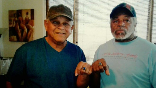 Governor Mitchell (right) and Burton Jordan pose with their rings.
