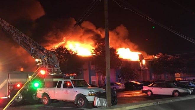 Roughly 200 residents have been displaced by a fire at the Iconic Village Apartments in San Marcos, Texas, according to officials.