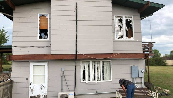 Hail and high winds damaged many homes in Froid Saturday.