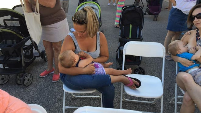 A mom breastfeeds her child at a Milwaukee Big Latch-on event in 2016.
