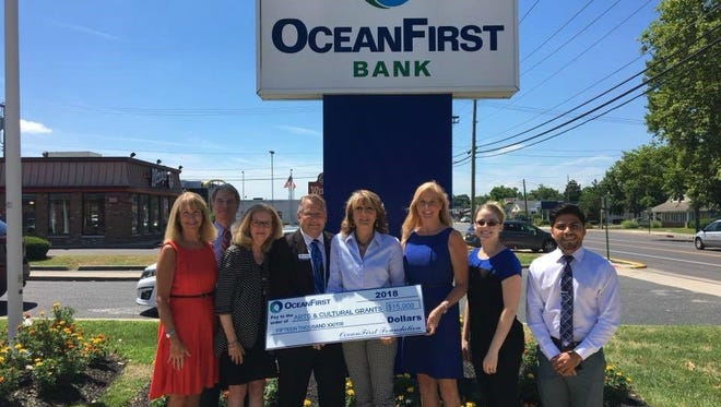 (From left) Rody Baron, development director, Arnold Robinson, board member, Susan Gogan, executive director, Wheaton Arts and Cultural Center; Edward Geletka, DBA OceanFirst Bank; Diane Roberts, executive director, Riverfront Renaissance Center for the Arts; Kathy Durante, executive director, OceanFirst Foundation; Amanda DeAngelis, general manager, Levoy Theatre; and Luis Maldonado, personal banker; were in attendance on July 18 as the OceanFirst Foundation presented donations totaling $15,000 to Millville organizations. The donation included $5,000 for each of the following: Levoy Theatre, Riverfront Renaissance Center for the Arts; and Wheaton Arts and Cultural Center. The presentation was part of the OceanFirst Foundation 2018 Arts & Cultural Grant Initiative, which will award $150,000 to 56 community organizations within the OceanFirst Bank footprint.