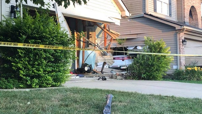 Officials said a car hit two homes in Carmel before coming to a stop. The driver is suspected of OWI, police said.