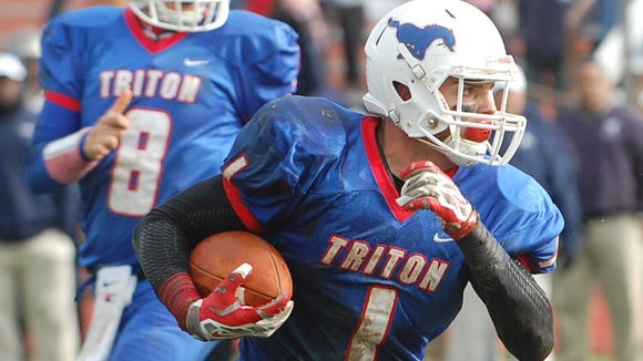 Kevin Bucceroni of Triton looks for running room against Timber Creek