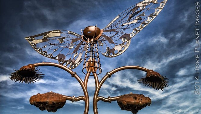 """""""Portal of Evolution"""" has been located in the City Plaza since July 2012 but city crews will relocate the sculpture Tuesday morning ."""