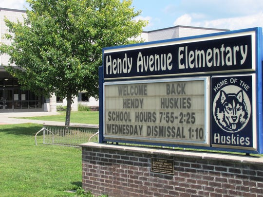 Like other schools around the region, a sign welcomes back students of Hendy Avenue Elementary School in West Elmira. Nearby on West Water Street, a portable road sign displayed vehicle speeds in the 20 mph school zone.