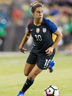 Decorated U.S. women's national team midfielder Carli Lloyd (10) opens up about a difficult family situation in her new autobiography.