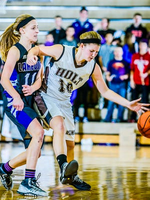 Tara Lierman ,right, of Holt keeps Ava Cook ,left, of Battle Creek Lakeview off the ball as Lierman brings the ball up the floor.