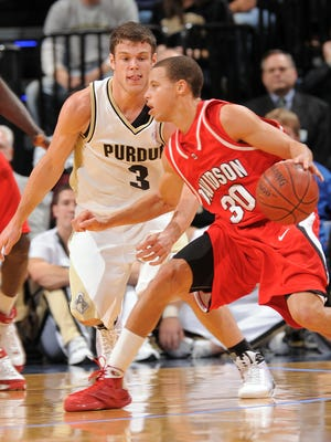 FILE – Purdue's Chris Kramer, left, plays tight defense on Davidson's Stephen Curry as the Boilers crushed the Wildcats 76-58 in the John Wooden Tradition at Bankers Life Fieldhouse, Dec. 20, 2008.