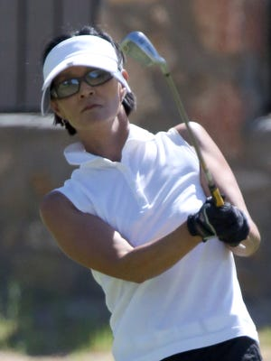 Soo Lee chips her way to the hole Saturday at Horizon Golf Club.