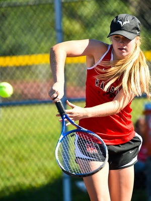 Marion Harding's Maggie Pitts returns a shot against Big Walnut last season. Pitts returns as the area's top girls tennis player.