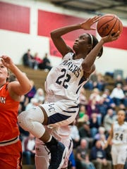 Lebanon Catholic's Neesha Pierre drives to the hoop.