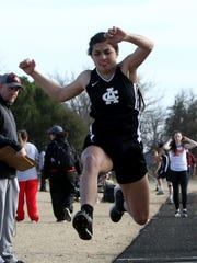 Archer City's Delaini Hanna competes in the triple jump at the Seymour Track Meet Thursday, March 8, 2018, in Seymour.