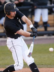 Ben Nisle of Purdue singles to drive in a run and put