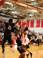 Canton's Vinson Sigmon goes to the basket Friday against