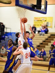 Redford Union's Christian Montgomery (right) goes up