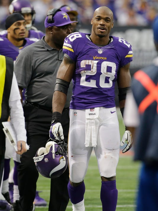 FILE - Minnesota Vikings running back Adrian Peterson walks on the sidelines during the first half of an NFL football game against the Chicago Bears, in this Dec. 1, 2013 file photo taken in Minneapolis. Peterson, who made a sensationally quick return from torn knee ligaments to win the 2012 NFL MVP award, says he's made sure he was completely informed on what he has been given throughout his career with the Minnesota Vikings, and in college at Oklahoma.  (AP Photo/Ann Heisenfelt)