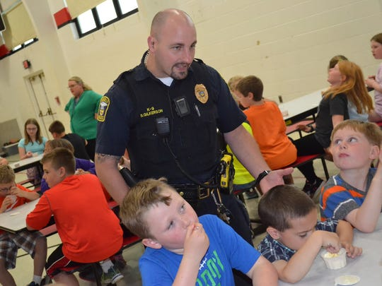 "Woodville K-9 officer Steve Gilkerson talks with children at ""Chillin' with a Cop."""