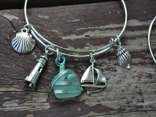 Many of the bracelets Cindy Millikan makes with Lake Erie beach glass and whimsical charms are nautical themed.