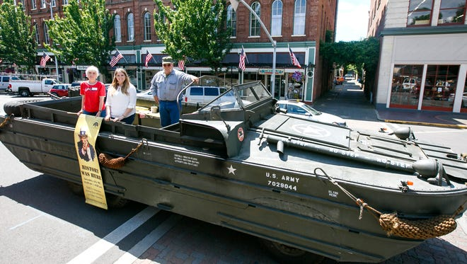 (Left to right) Kathleen Schulte and Jenna Wyatt of the Willamette Heritage Center with vehicle collector Matt Richards brought a 1944 amphibious vehicle to Holding Court on Tuesday, July 5, 2016. The center is sponsoring a History Was Here event this Saturday, July 9.