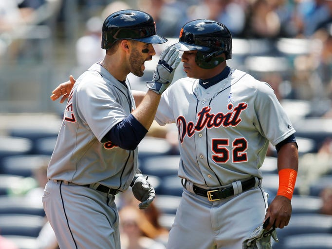 Detroit Tigers J.D. Martinez, left, celebrates with