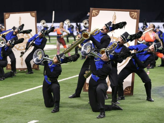 The Carmel High School Marching Band competes during