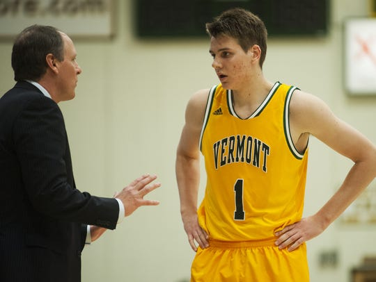 Vermont head coach John Becker talks to Catamounts
