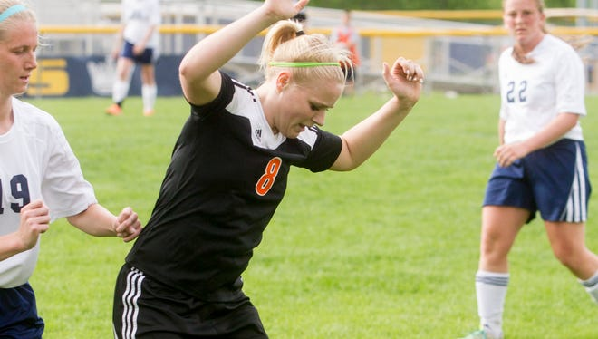 Solon's Brianna Pike works for positions against Regina's Angela Klein during the Spartans game against the Regals at Regina in Iowa City, IA on Tuesday, May 27, 2014.