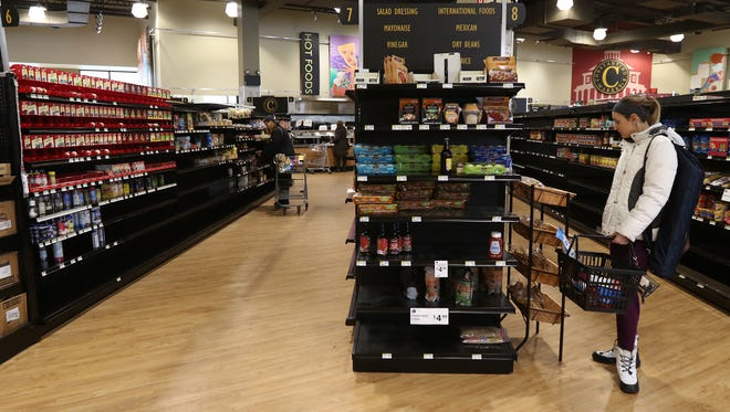 """Krysta Smith, who works close by, said about shopping at ConstantinoÕs was """"very convenient.Ó  She said ÒI donÕt think a lot of people knew about it.  It was tucked back in here.Ó  She said she also liked the store because it offered a lot of local products and products made within the state."""