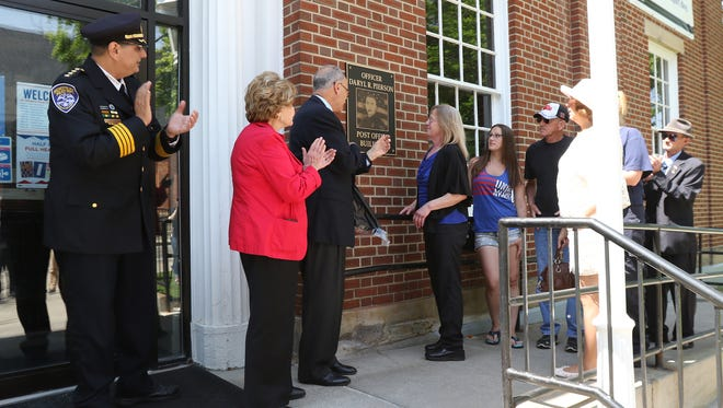 The East Rocheste Post Office was renamed for Officer Daryl R. Pierson. Unveiling the plaque were Rochester Police Chief Michael Cimminelli, Congresswoman Louise Slaughter, Sen. Charles Schumer, Daryl Pierson's mother Debi Pierson and Daryl Pierson's sister Julie, as well as other family members.