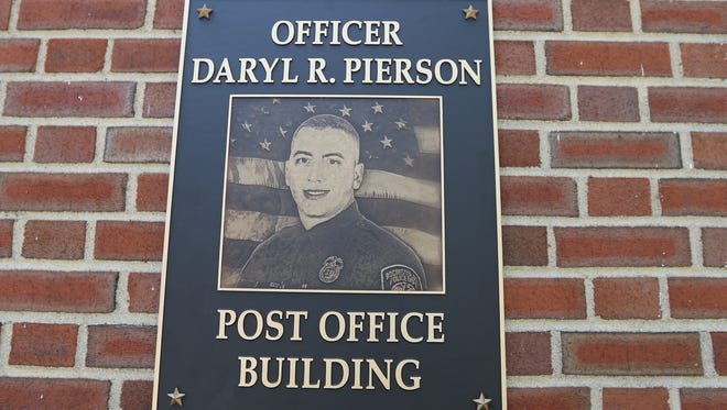 The East Rochester post office was dedicated and renamed the Officer Daryl R. Pierson Post Office, after the Rochester police officer who was slain while on the job in 2014. A plaque was mounted near the front entrance.