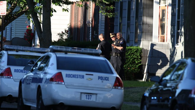 Police investigate the shooting of a 28-year-old man on Hague Street in 2015.