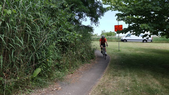 A bicyclist detours onto a trail off Sawgrass Drive in Brighton to get back on the Erie Canal.